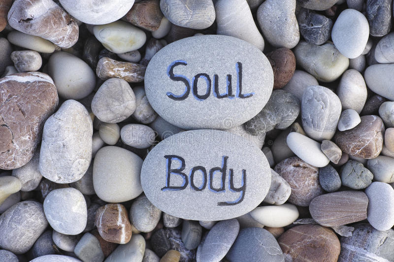 Body and Soul. Words Body and Soul written on stones. Close up stock images
