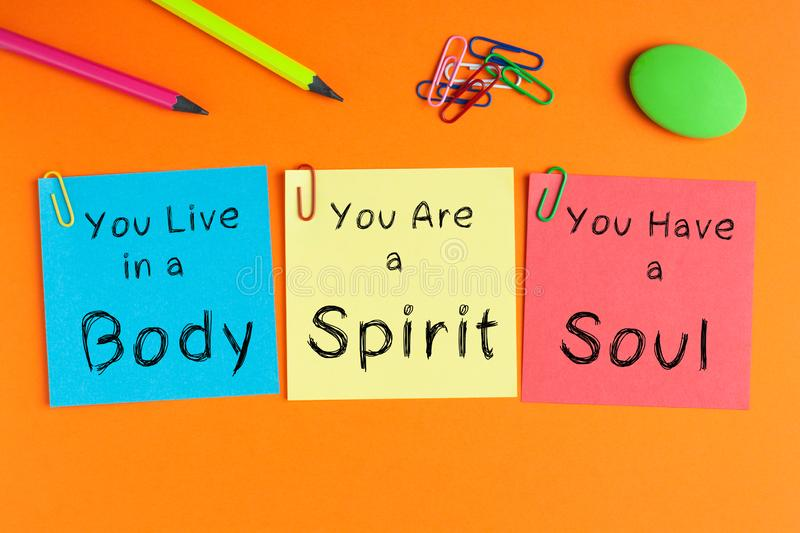 Body Spirit Soul. Written on color notes with and office supplies stock photo