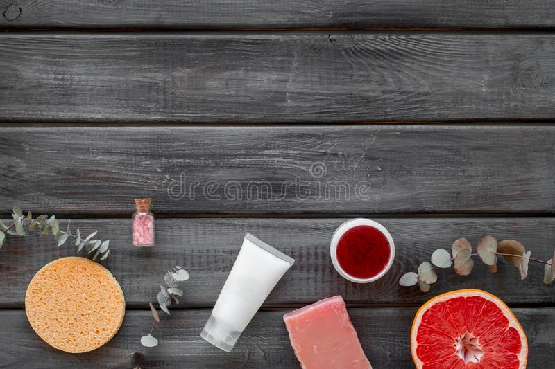 Cosmetics with natural herbal and citrus ingredients on gray wooden background top view copyspace royalty free stock images
