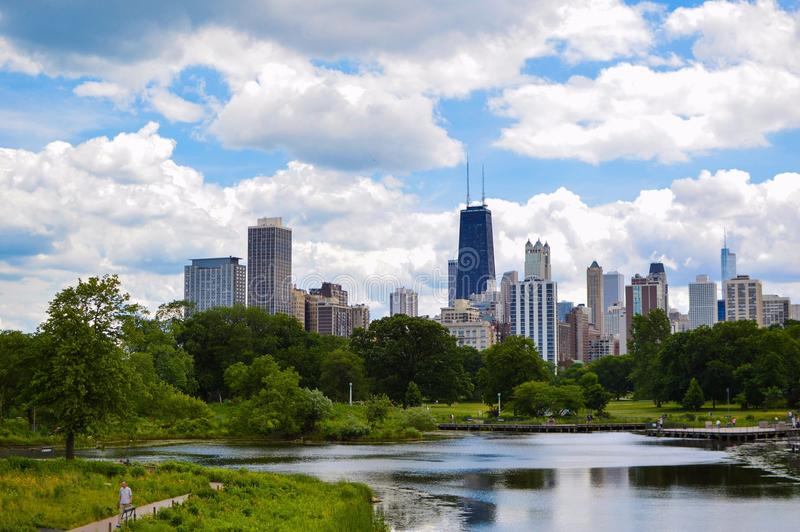 Body of Water, Forest, Then City Buildings stock photo