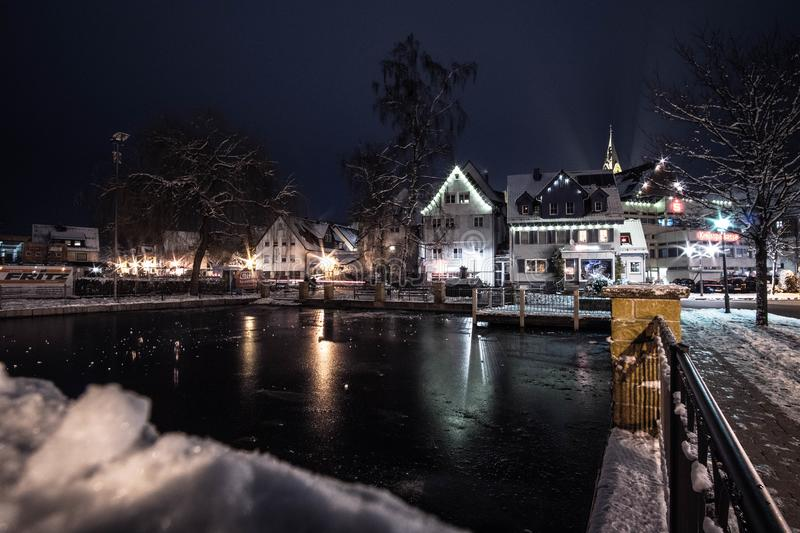 Body of Water Infront of White 3-storey Houses during Night Time stock photos