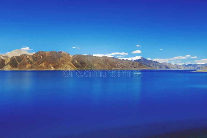 Body of Water Near Mountain Hills royalty free stock image