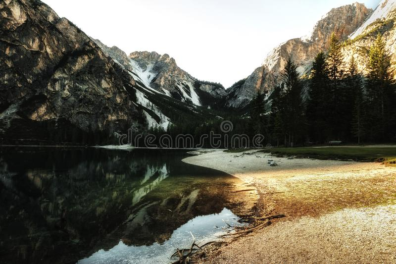 Body of Water Near Trees during Sunset stock photography