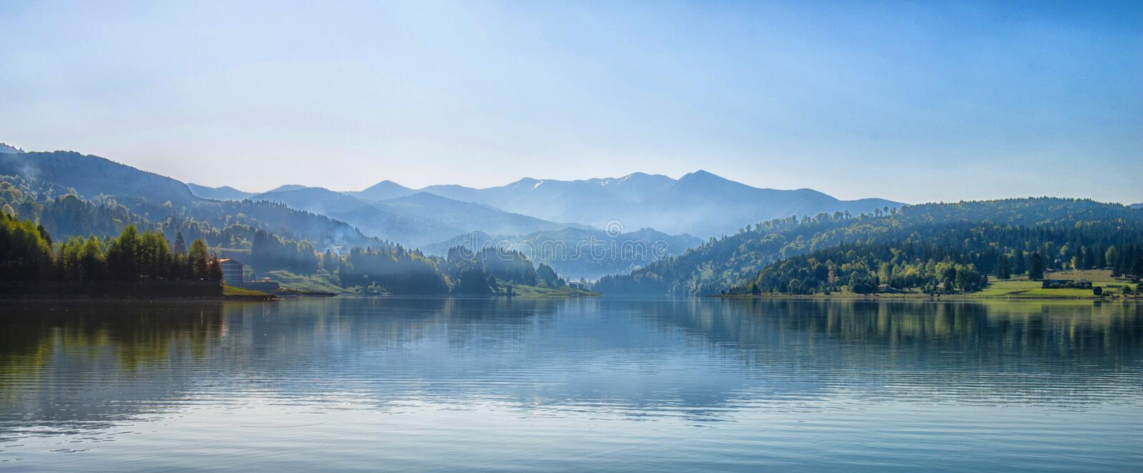 Body of Water Next to Mountain during Day Time stock photos