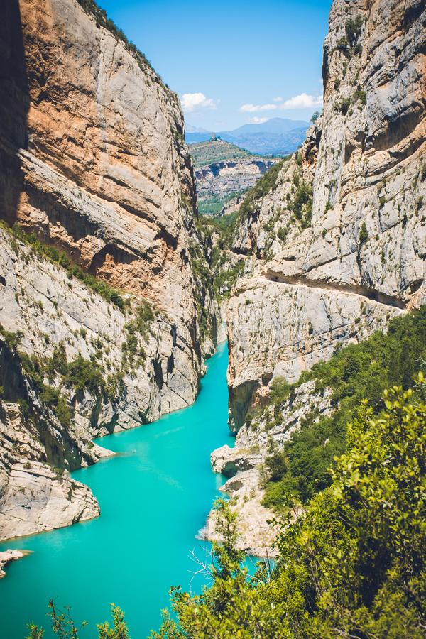 Body of Water Surrounded by Mountain Under Blue Sky at Daytime stock images