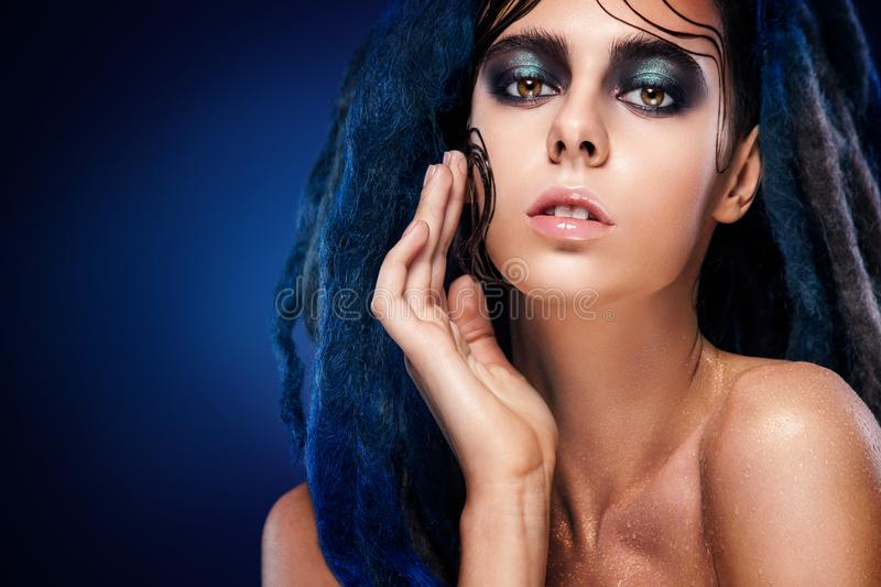 Bodyart model girl portrait with colorful paint make up. woman bright color makeup. Closeup of vogue style lady face, Art des royalty free stock image