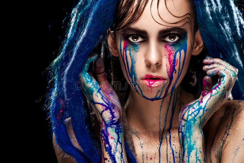 Bodyart model girl portrait with colorful paint make up. woman bright color makeup. Closeup of vogue style lady stock images