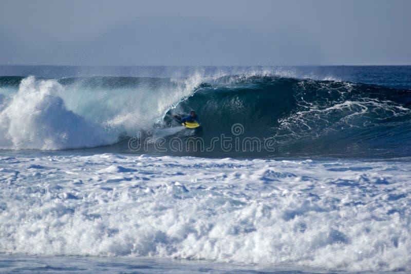 Bodyboarder 1. Bodyboarder carving on El Quemao in La Santa, Lanzarote royalty free stock images