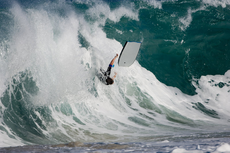 Bodyboarder wipes out stock photos