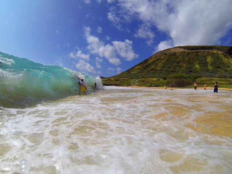 Bodyboarding Sandy Beach Hawaii stock foto's