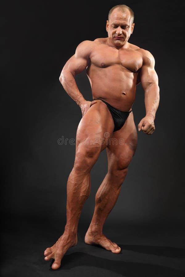bodybuilder αφές toe πατωμάτων άντυτες στοκ φωτογραφία με δικαίωμα ελεύθερης χρήσης