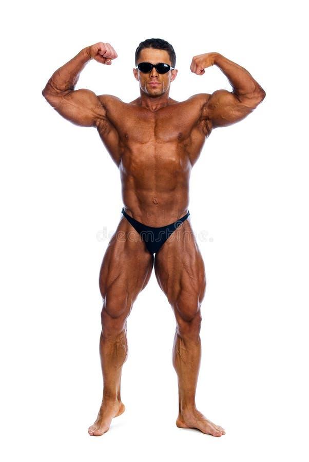 Bodybuilder affichant ses muscles image stock