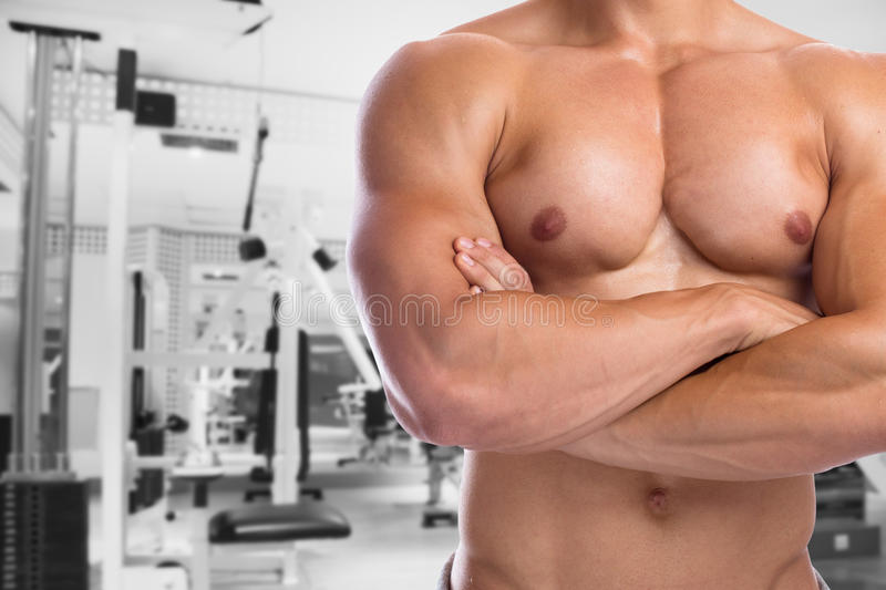 Bodybuilder bodybuilding flexing chest muscles posing fitness gym body builder building strong muscular man royalty free stock photo