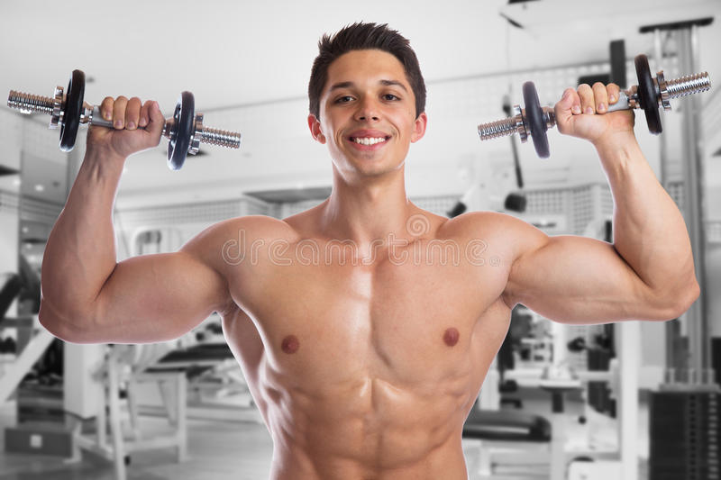 Bodybuilder bodybuilding muscles body builder building gym strong muscular young man dumbbells shoulder training royalty free stock photos