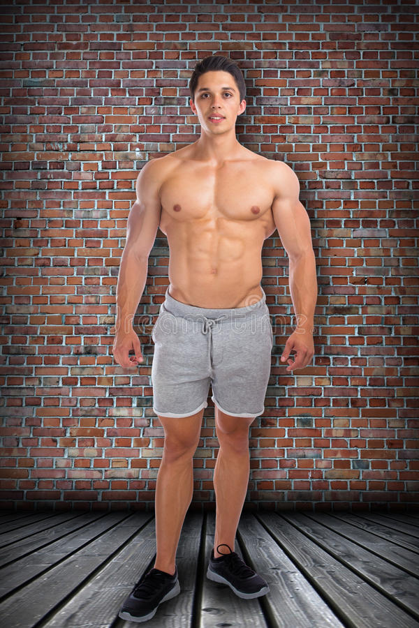 Bodybuilder bodybuilding muscles standing whole body portrait mu. Scular man sixpack royalty free stock image