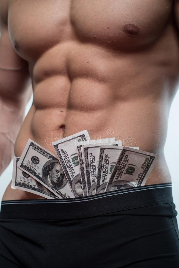 Man with dollars. Bodybuilder with cash in undewear stock images