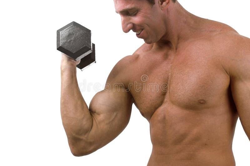 Bodybuilder con i pesi fotografia stock libera da diritti