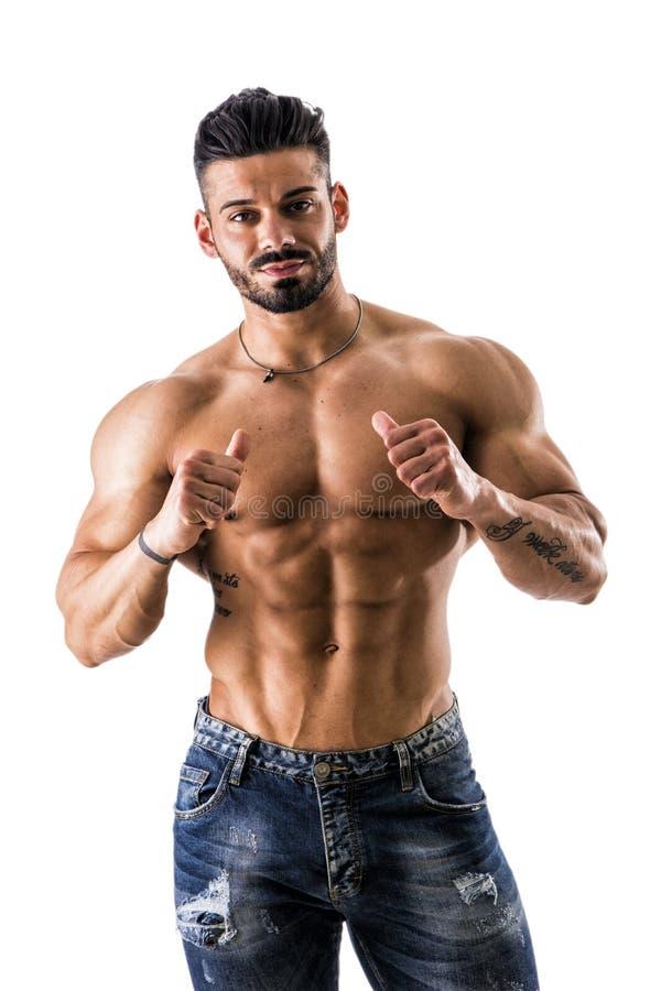 Bodybuilder dirigeant le doigt de pouce à se images libres de droits