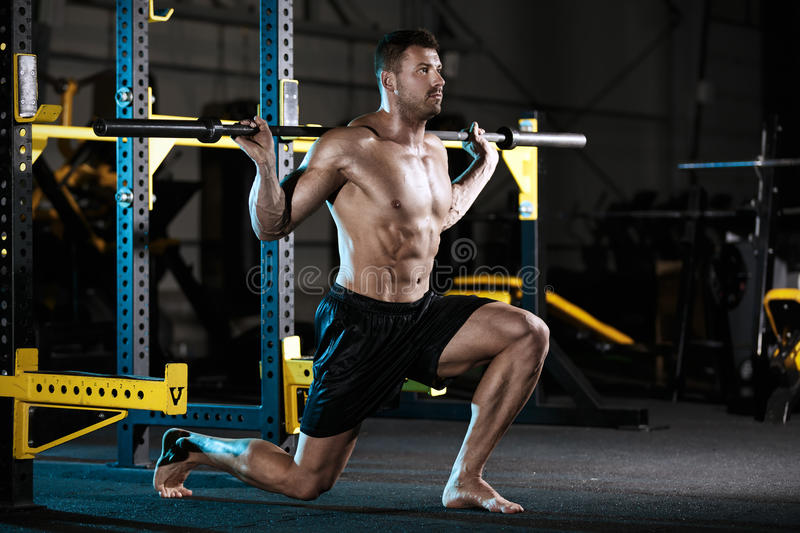Bodybuilder exercising with weights stock image