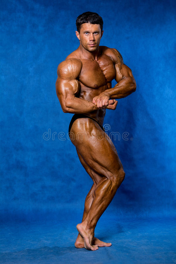 Bodybuilder flexing his muscles. royalty free stock photos