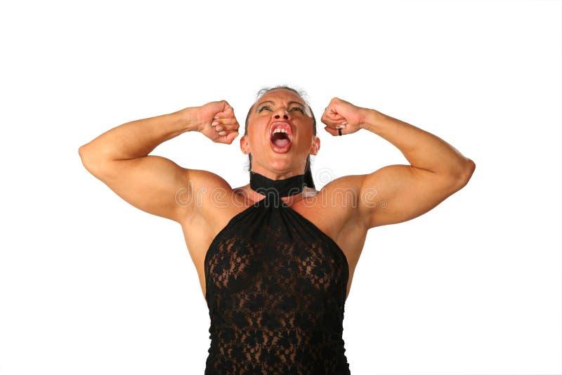 Bodybuilder gridante della donna fotografia stock libera da diritti