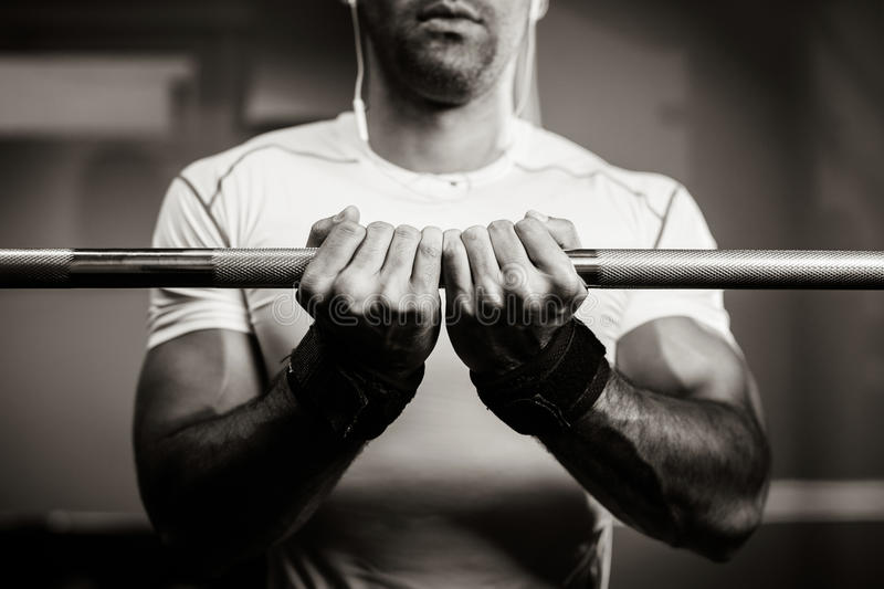 Bodybuilder guy hands close up monochrome stock photography