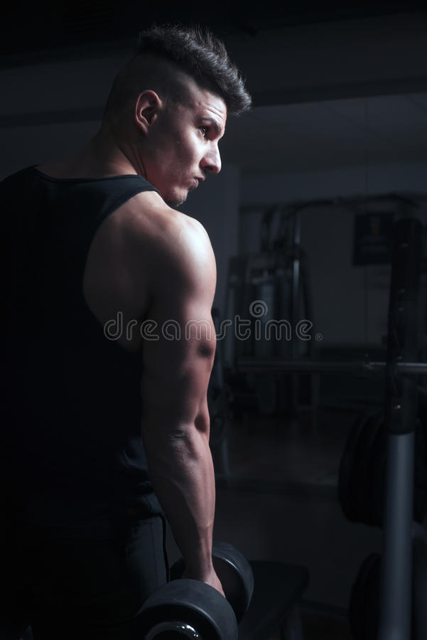 Bodybuilder at gym royalty free stock photos