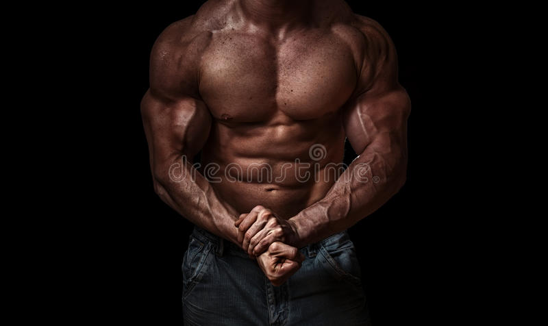 Bodybuilder. Isolated on black background. Strong - hard muscle royalty free stock photo