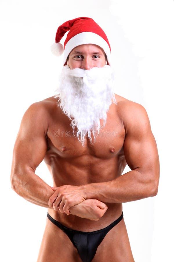 Bodybuilder le père noël image stock