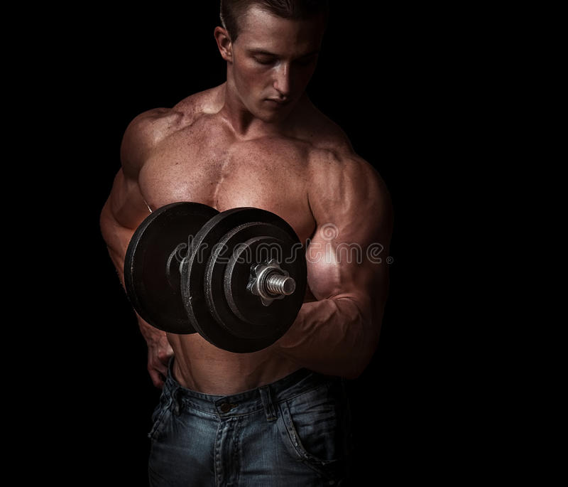 Bodybuilder. Man with a bar weights in hands training. Bodybuilding stock photos