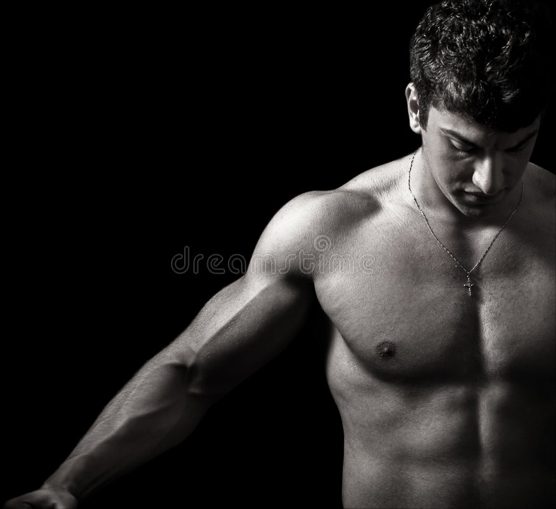 Bodybuilder masculino muscular artístico foto de stock