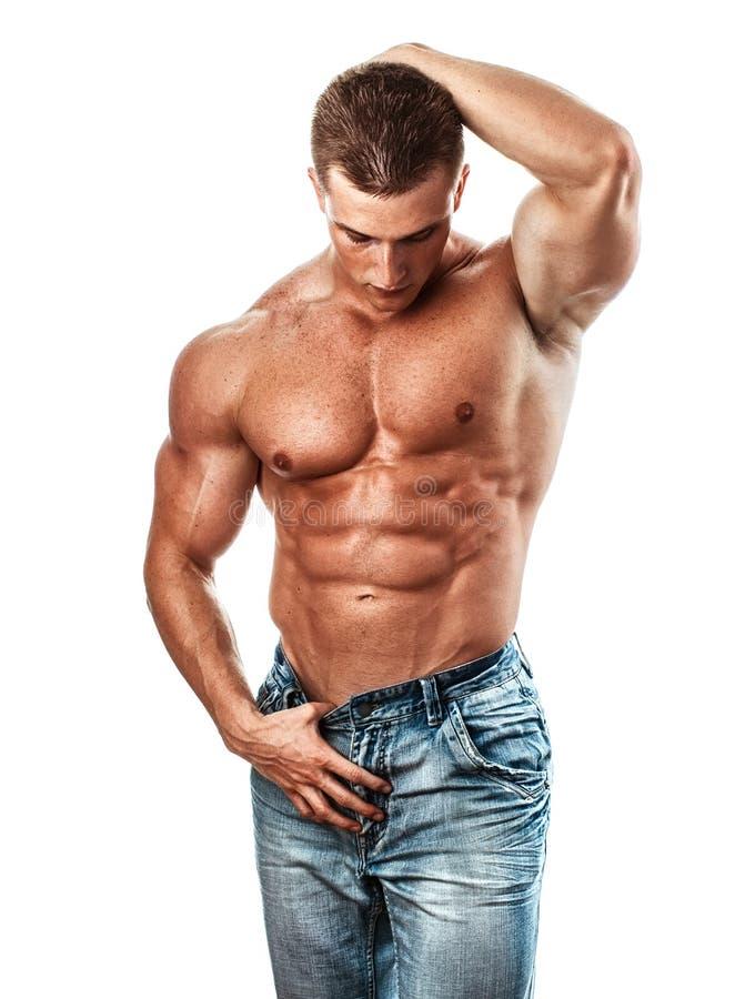 Bodybuilder. Muscular handsome guy posing, isolated on white stock photo