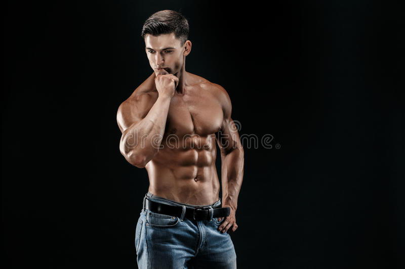 Bodybuilder posing. Beautiful sporty guy male power. royalty free stock images