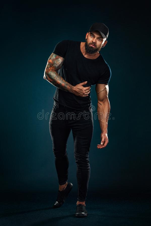 Strong and fit man bodybuilder. Sporty muscular guy athlete. Sport and fitness concept. Men`s fashion in full height. stock photos