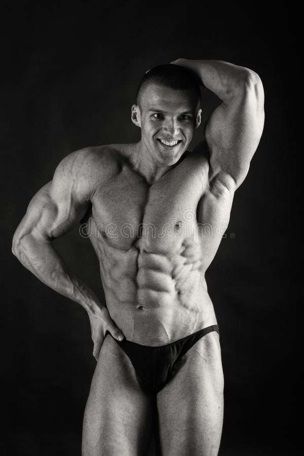 Male showing muscles stock images