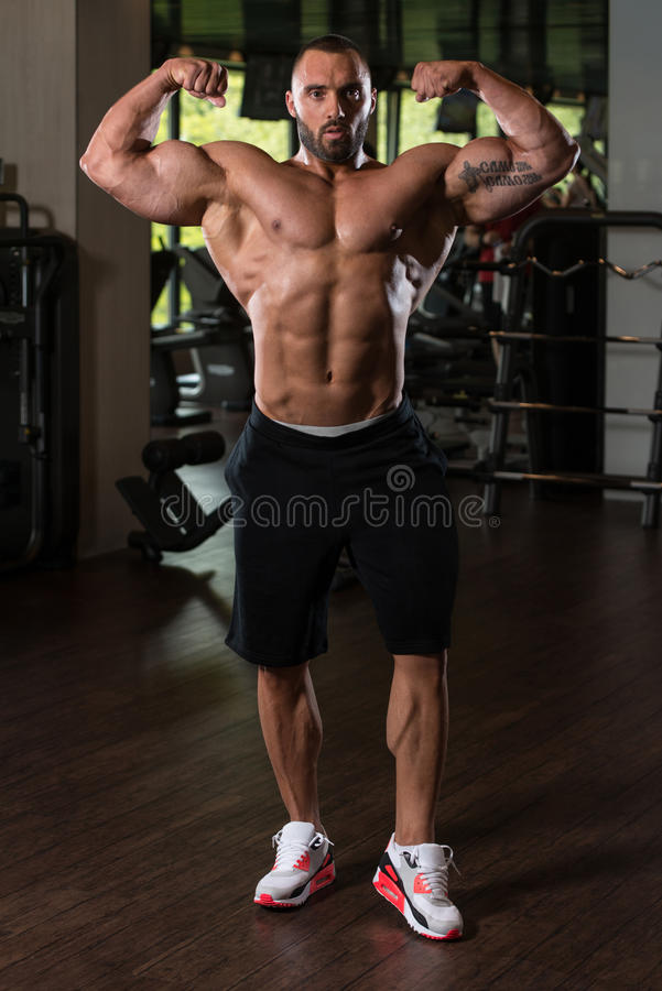 Bodybuilder Posing In The Gym royalty free stock photo