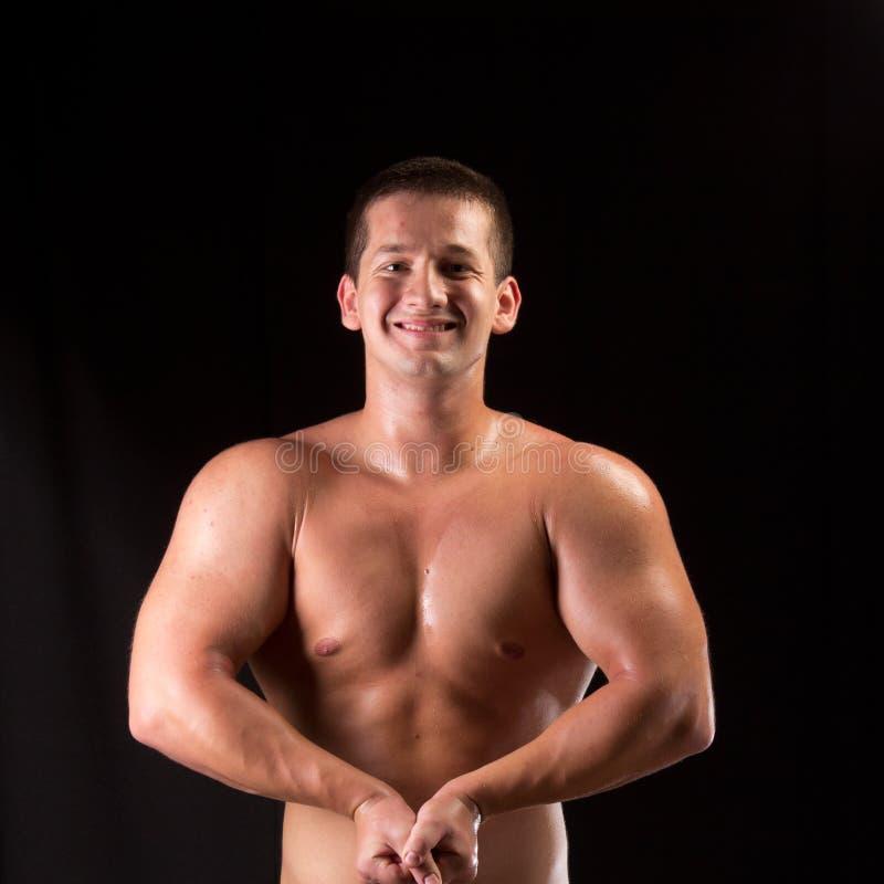 Bodybuilder pozować obrazy stock