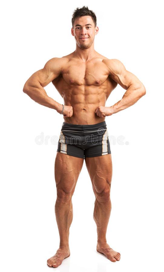 Bodybuilder pozuje nad bielem zdjęcia royalty free