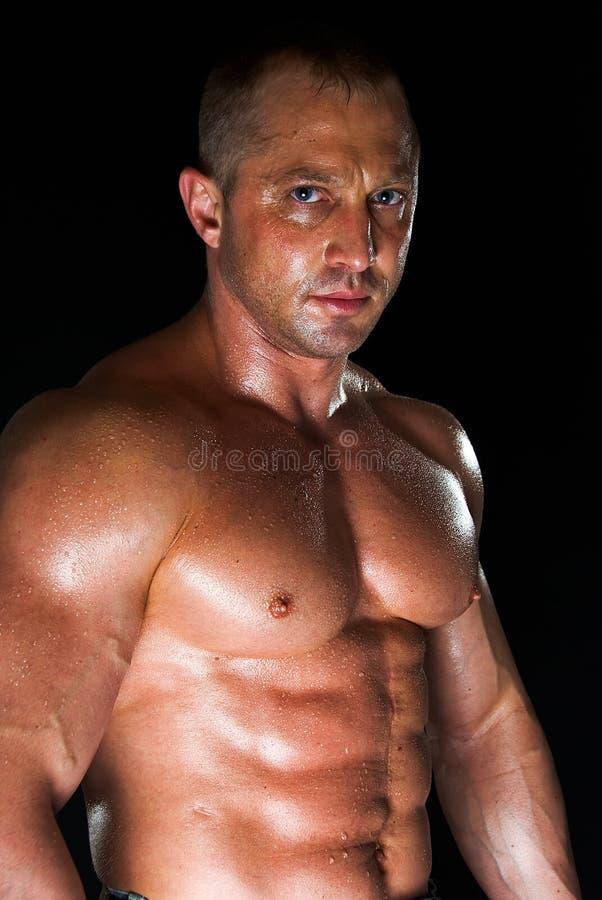 bodybuilder przepocony obraz stock