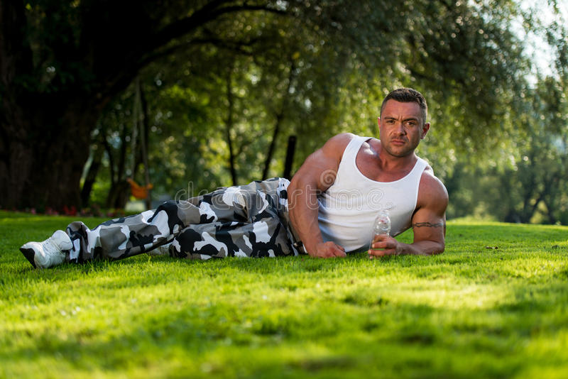 Download Bodybuilder Resting And Holding Water Bottle Stock Photo - Image: 34978802