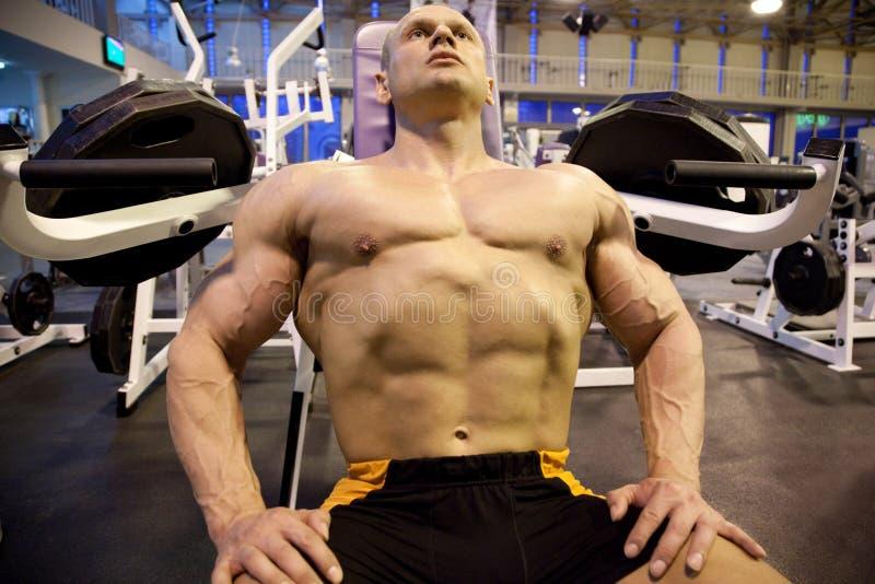 Download Bodybuilder Rests In Training Room Stock Photo - Image: 11140800