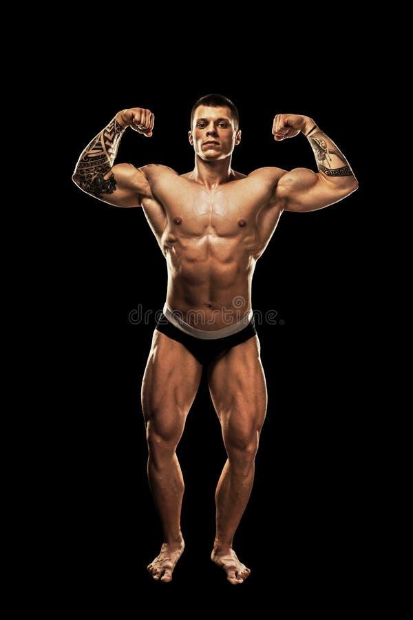 bodybuilder target313_0_ Pi?knego sporty faceta m?ska w?adza Sprawno?ci fizycznej mi??niowy cia?o Odizolowywaj?cy na czarny tle fotografia royalty free