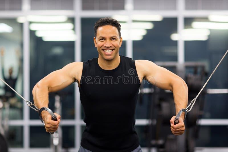 Bodybuilder triceps practice stock images