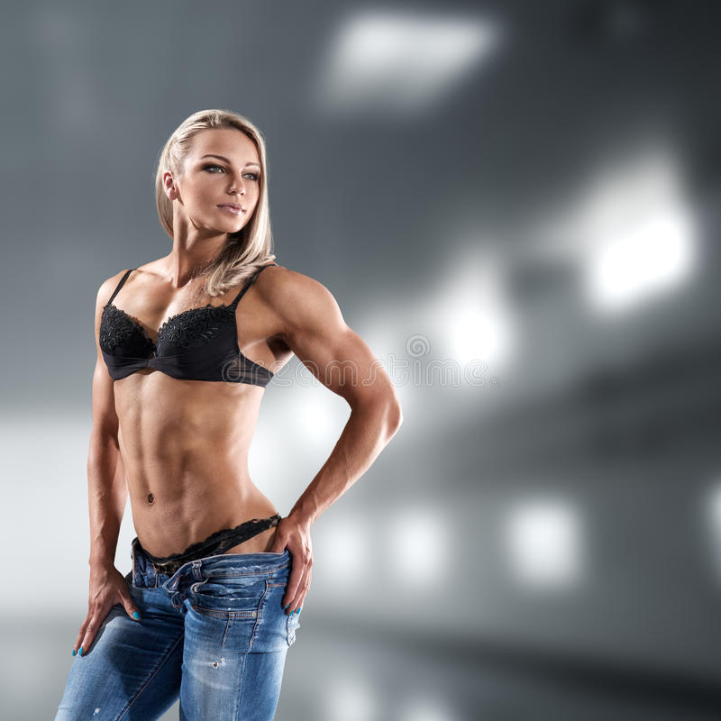 Bodybuilder woman in bikini. Bodybuilder athletic woman in bikini showing her muscles royalty free stock photography