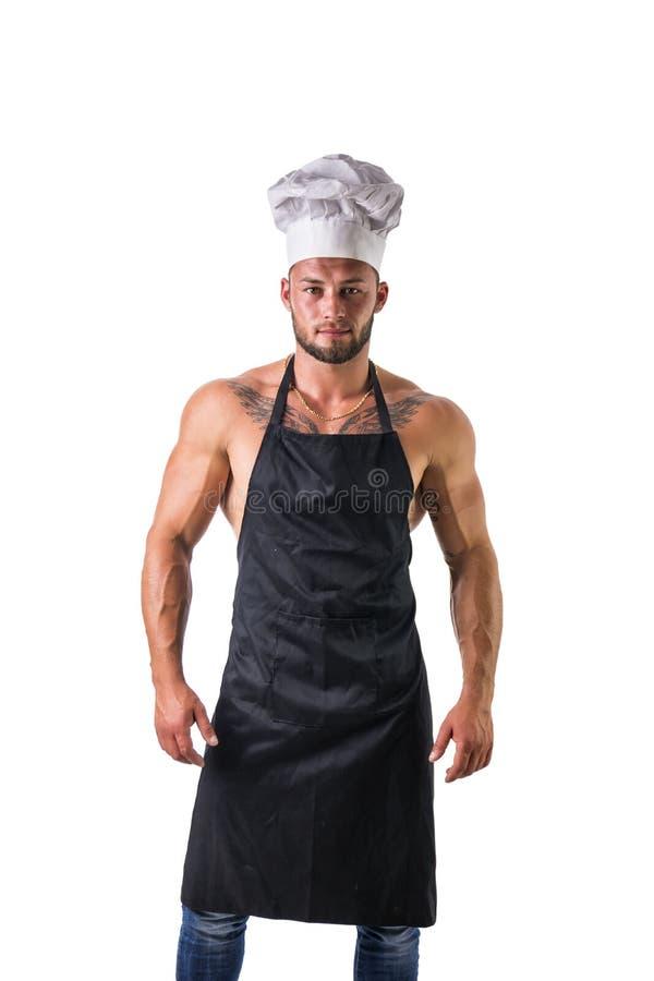 Bodybuilderchef-kok met Schort op Naakt Spierlichaam stock afbeeldingen
