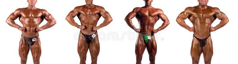 Bodybuilders het buigen stock foto's