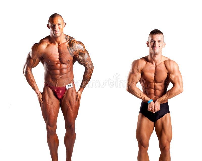 Bodybuilders pozować obrazy stock