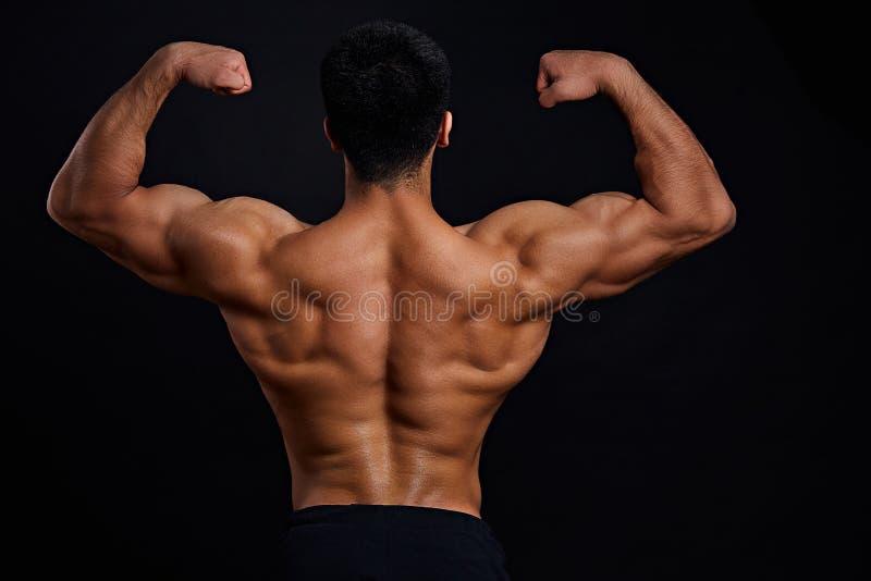 Bodybuilders trainingsprogramma Achtermeningsfoto stock foto's