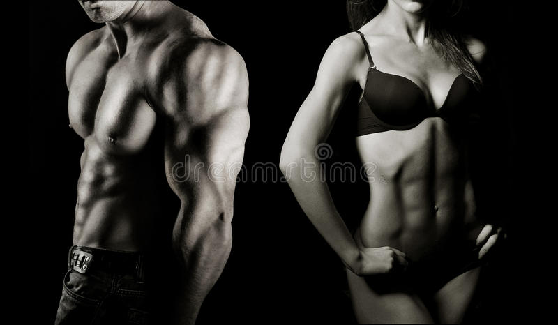Bodybuilding. Άνδρας και γυναίκα στοκ εικόνα με δικαίωμα ελεύθερης χρήσης