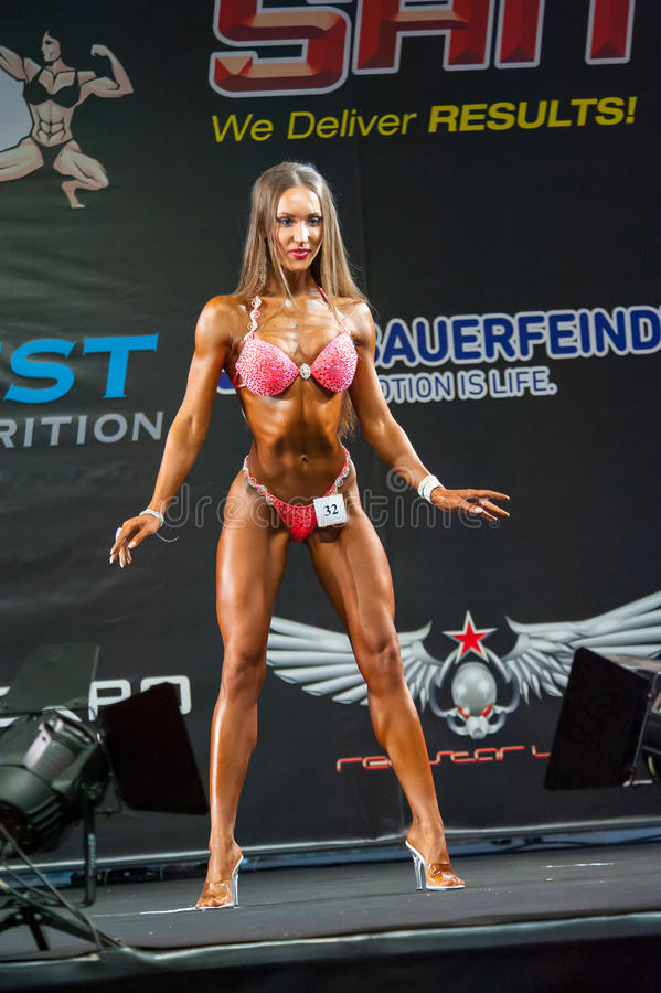 Bodybuilding Champions Cup. MOSCOW, RUSSIA - NOVEMBER 21, 2015: Daria Goloshumova participates in Bodybuilding Champions Cup during SN Pro Expo Forum 2015 on stock photography